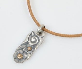 SOLD Oblong Pendant and Rawhide Necklace by Javier Ribeyrol